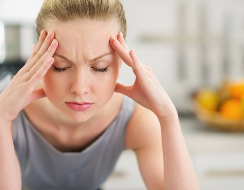 Woman-holding-head-migraine-pain